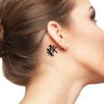 simple single word tattoo behind Ear deep meaning