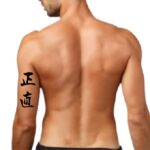 'Integrity, Honesty' tricep tattoo words, japanese Kanji symbol letter tattoos on arm