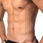 Japanese Scripture Tattoo on Ribs