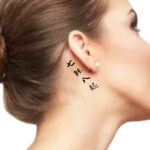 fall down seven times stand up eight tattoo japanese kanji Symbols behind the ear