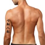 fall down seven times stand up eight tattoo japanese Kanji Letters on Tricep
