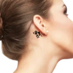 Small word tattoo behind the ear for female