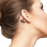 Japanese text tattoo women behind the ear