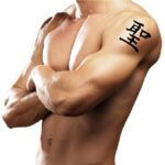 Kanji tattoo on arm shoulder